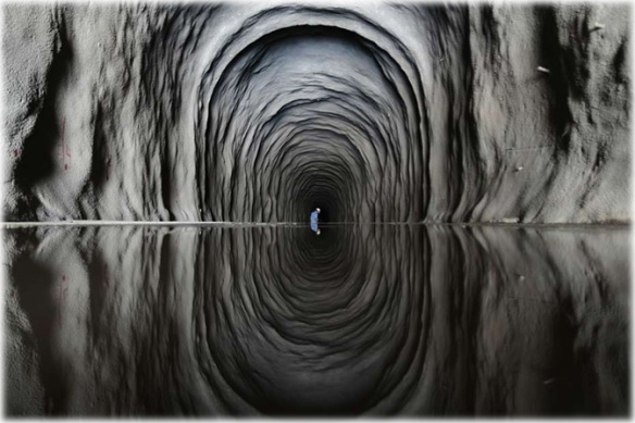 A worker is seen inside the Cuncas II tunnel that will link the canals being built to divert water from the Sao Francisco river for use in four drought-plagued states, a project that is three years behind schedule and has doubled in cost from the original estimate of $3.4 billion, near the city of Mauriti, Ceara state, January 28, 2014. In 2006, then President Luiz Inacio Lula de Silva, pushed through an idea that long-suffering residents of the region had been hearing about for more than a century. By 2010, Lula de Silva said, water would be pumped over hills and into a 477 kilometer-long network of canals, aqueducts and reservoirs to quench thirsty cities and farms in four states. Eight years later, and near the end of a first term for Lula's hand-picked successor as president, Dilma Rousseff, the project is only half built. Picture taken January 28, 2014. To match Feature BRAZIL-DROUGHT/CANAL REUTERS/Ueslei Marcelino (BRAZIL - Tags: POLITICS ENVIRONMENT AGRICULTURE BUSINESS TPX IMAGES OF THE DAY CONST